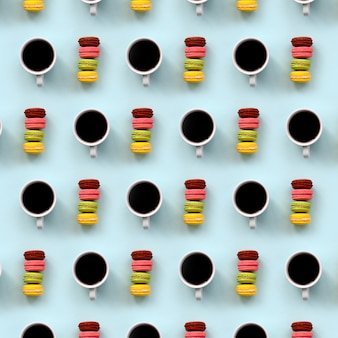 A pattern of many colorful dessert cake macaroon and coffee cups