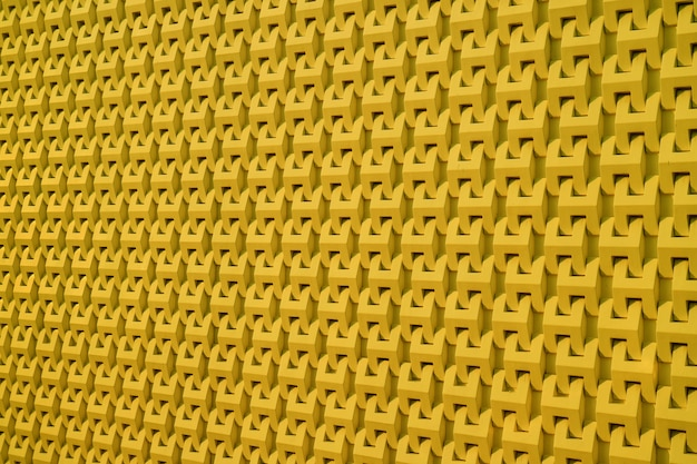 Pattern of the modern building outer wall in mustard yellow color background