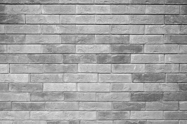 背景として装飾的な灰色のスレートの石の壁の表面のパターン。淡い灰色