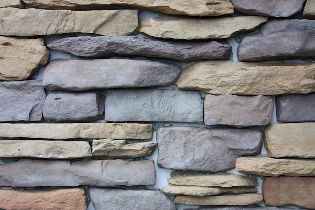 装飾的なスレートの石の壁の背景テクスチャのパターン