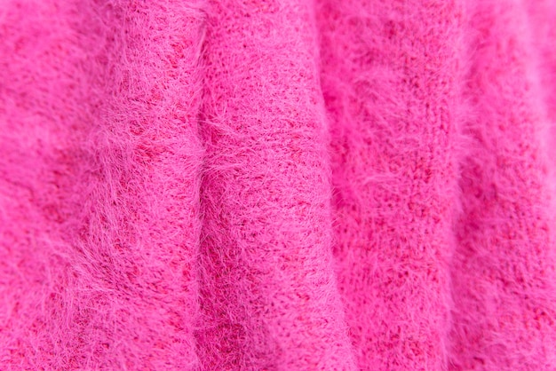 ピンクのニットセーターのクローズアップのパターン