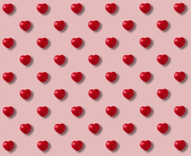 Узор из красных сердечек на розовом фоне