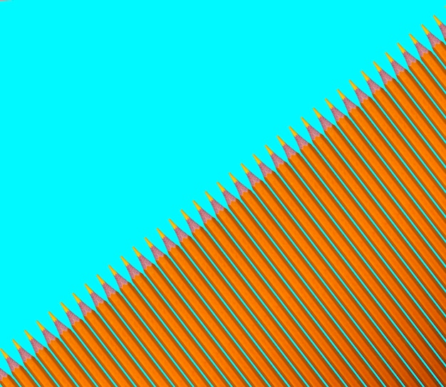 청록색 바탕에 노란색 연필의 패턴