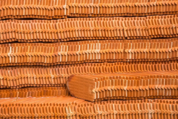 The pattern of piles of roof tiles for the background.