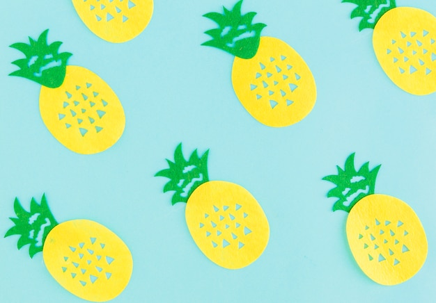 Pattern of pineapples on light background