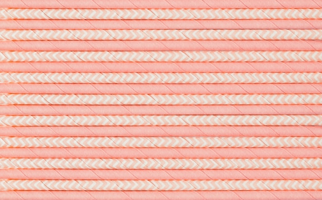 Pattern of pink paper straws for cocktails