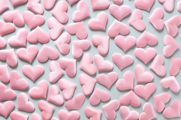 Pattern of pink romantic hearts on blue background. valentine's day texture. love concept.