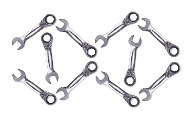 Pattern of ratchet wrenches, chromed metal, tool for fixing nuts and bolts. white background isolate view from the top.