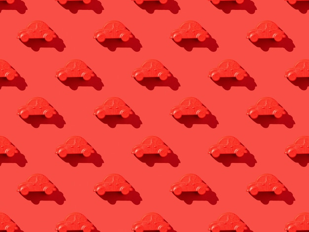 A pattern of red cars on a bright red surface
