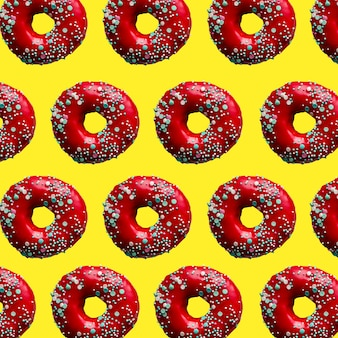 Pattern red donut with pastry sprinkles on yellow background