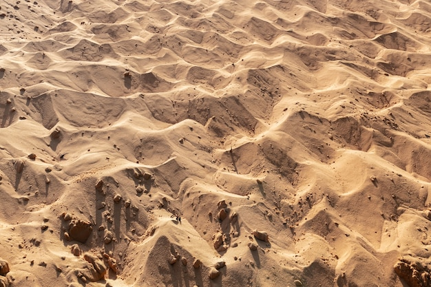 Pattern of red sand mix white sand