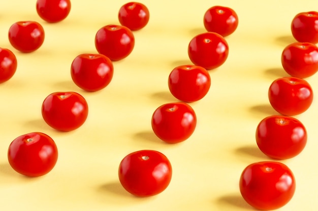 Pattern of red tomatoes on a light yellow background.