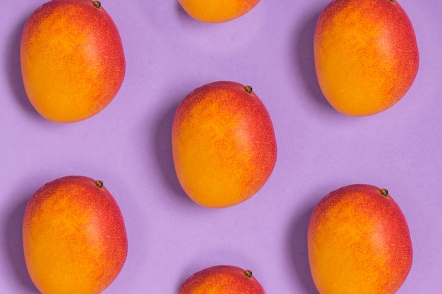Pattern of ripe tropical mangoes purple