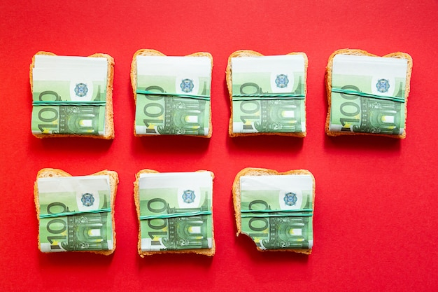Pattern of sandwiches with one hundred euro bills