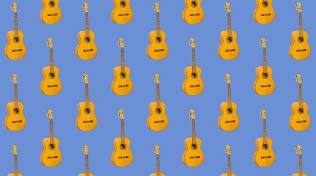 Шаблон бесшовные акустическая гитара на синем фоне. образец с инструментом для музыки. минималистичная концепция музыки. гитара печать