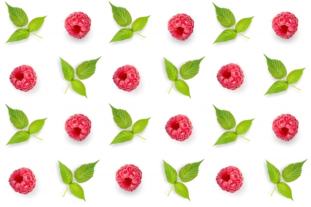 Pattern, seamless, set with raspberries and green leaves isolated on white background.