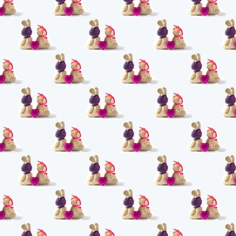 Pattern seamless, toys hares with pink heart