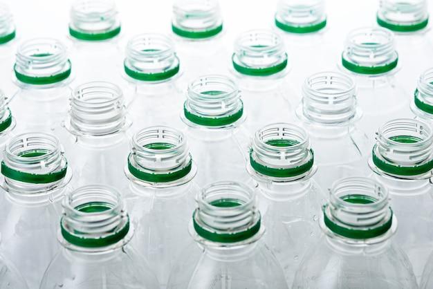 Pattern of transparent plastic bottles without lids