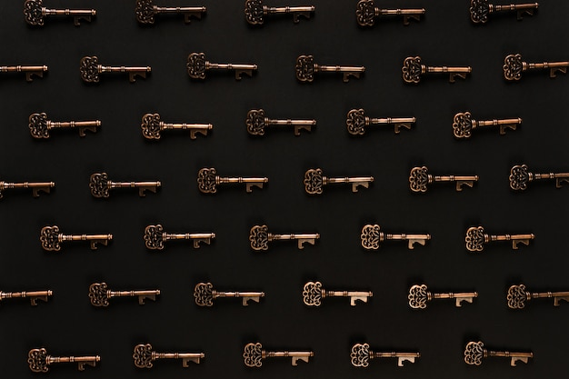 Pattern of vintage keys and black scene