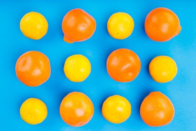 Pattern of whole oranges on blue backdrop