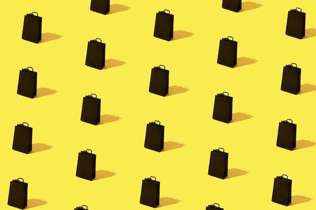 노란색 배경에 검은색 쇼핑백 판매 패턴