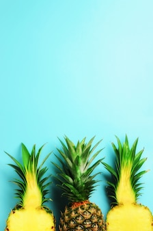Pattern with bright pineapples on blue