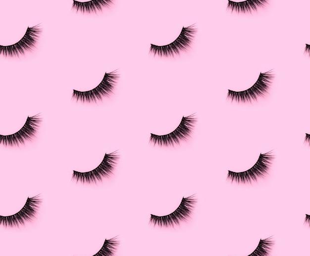 Узор с ресницами на розовом фоне. вид плоской планировки