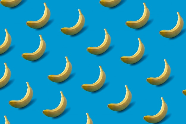 Pattern of yellow bananas on blue.