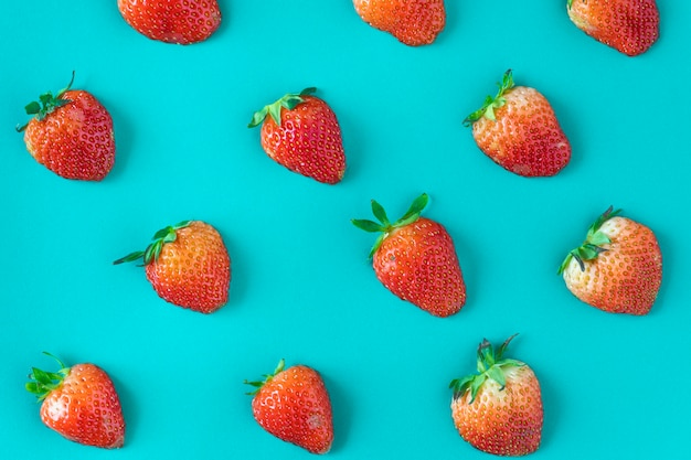 Pattern of yummy strawberries on blue background