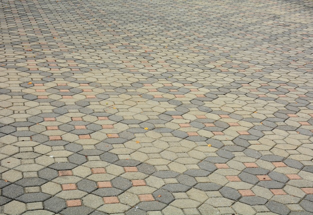 Patterned paving tiles, old cement brick floor background