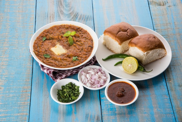 Pav bhaji indian spicy fast food with bread, onion and butter, indian food, mumbai food