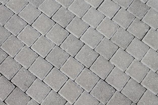 タイルの形の天然石で作られた舗装。デザイナーのためのテクスチャの背景。