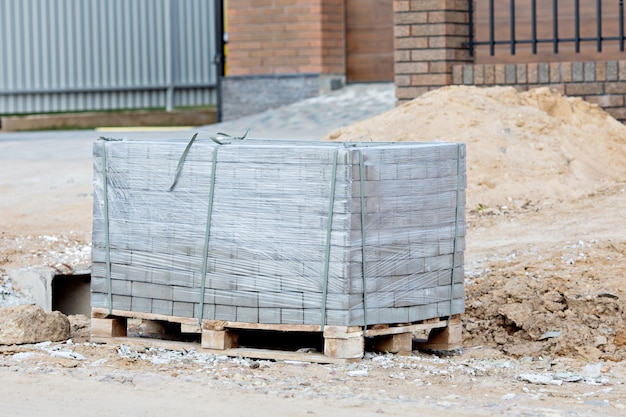 Paving slabs on pallet. the concept of new construction