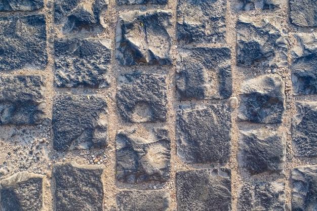 포장 돌, 화강암 정사각형 돌, 배경 질감. 고품질 사진