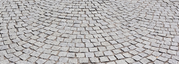 Paving stone on old road in lyon city, panoramic view