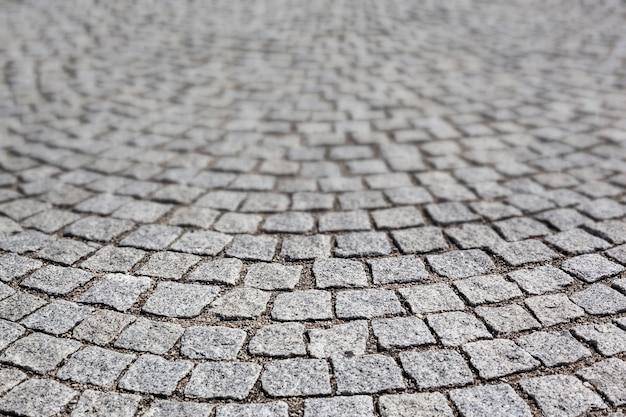 フランス、リヨン市の古い道路に石を敷く