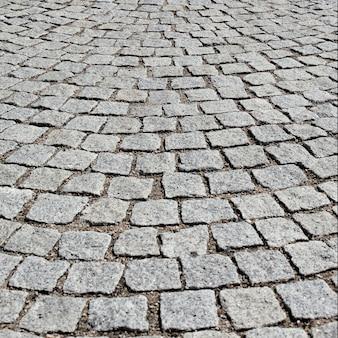 リヨン市の古い道路に石を敷く