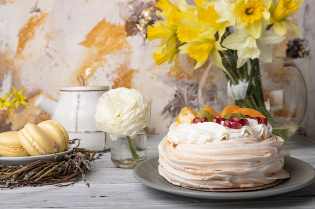 Pavlova is a meringue-based cake topped with fruit and whipped cream