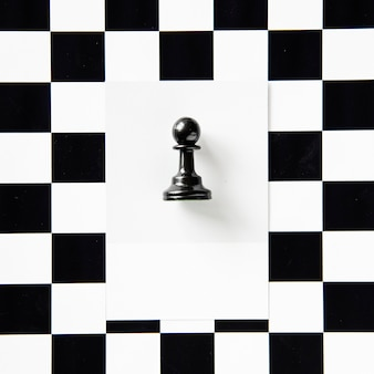 Pawn chess piece on a pattern
