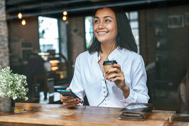 Pay for coffee by credit card through a smartphone in cafe