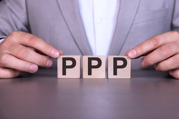 Paycheck protection program ppp, the word is written on wooden cubes