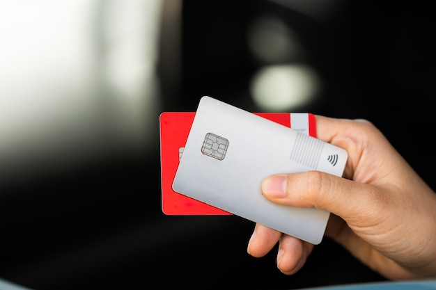 Paying or pay using a credit card shopping and retail concept, paying in car