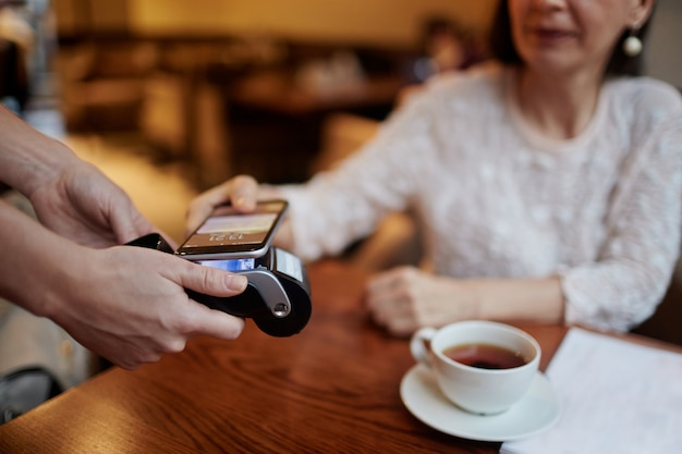 Paying for tea with contactless