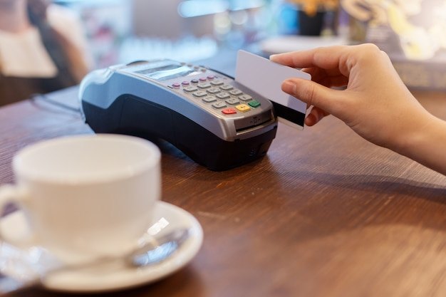 Paying with credit card for purchase in cafeteria