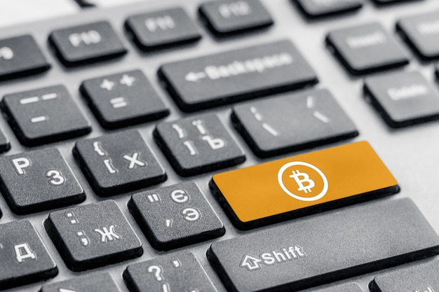 Payment bitcoin button on the keyboard, access concept