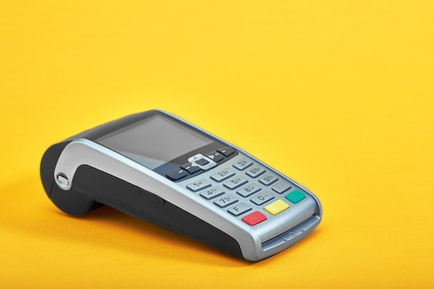 Payment terminal, compact pos terminal on yellow background