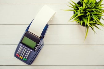 Payment terminal on white background top view