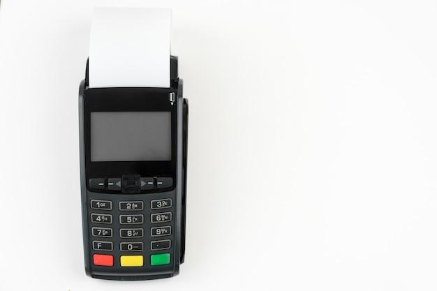 Payment terminal pos with a roll cash tape on the white background with copy space