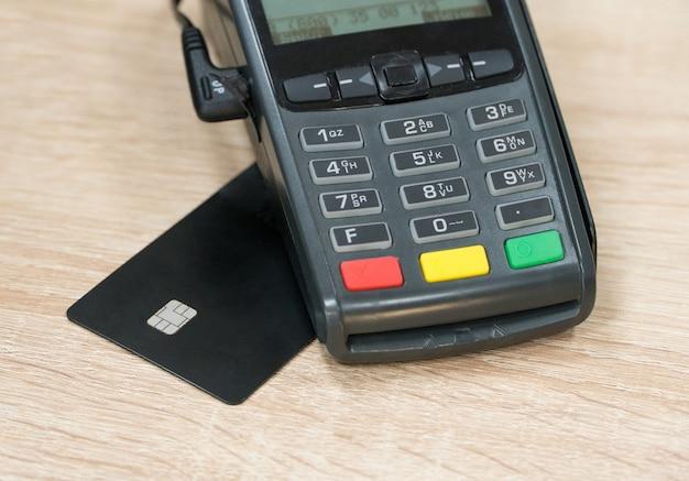 Payment terminal with card. close-up