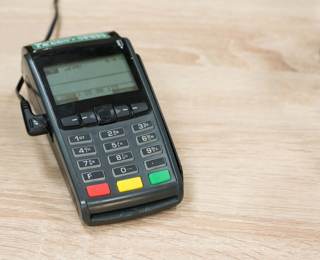 Payment terminal on a wooden background